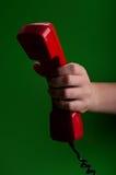 Женщина держа красный телефон Стоковая Фотография RF