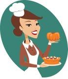 Женщина держа пирог тыквы бесплатная иллюстрация