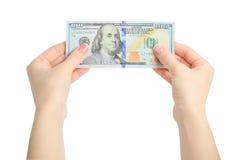 Женщина делать рука держа 100 долларов изолированный на белой предпосылке Стоковая Фотография