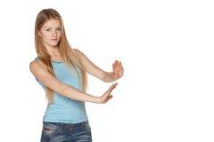 Женщина делая выжимк показывать Стоковые Фотографии RF