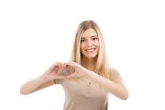 Женщина делая сердце с ее руками стоковое фото rf