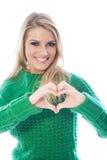 Женщина делая форму сердца с ее руками Стоковые Фотографии RF