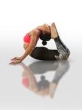 Женщина делая kapotasana йоги Стоковое Фото