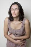 женщина живота боли стоковая фотография rf