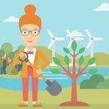 Женщина засаживает дерево Стоковое Изображение RF