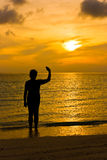 женщина захода солнца Стоковые Фото