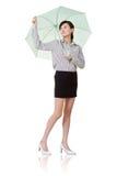 женщина зонтика удерживания дела Стоковая Фотография