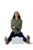 Женщина играя видеоигру на компьтер-книжке против белой предпосылки Стоковые Изображения RF