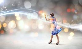 Женщина играя файф Стоковое Изображение