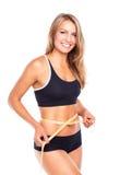 Женщина измеряя совершенную форму красивой бедренной кости, здоровое lifest Стоковое фото RF