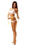 Женщина измеряя совершенную форму красивой бедренной кости Стоковая Фотография