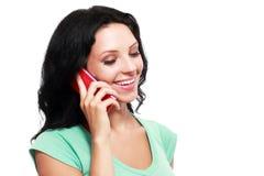Женщина используя телефон стоковое фото