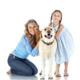 Женщина и девушка с собакой Стоковая Фотография