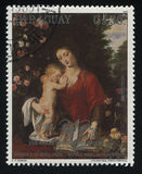 Женщина и ребенок читая книгу Rubens Стоковое Фото