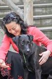 Женщина и собака Стоковые Изображения