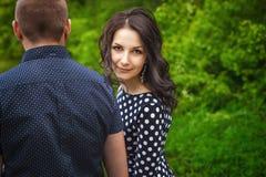 Женщина и человек идя в природу Стоковое фото RF