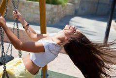 женщина качания Стоковая Фотография