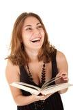 женщина книги смеясь над Стоковая Фотография RF