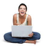 женщина компьтер-книжки смеясь над Стоковое Изображение RF