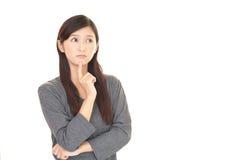 Женщина которая потревожена Стоковое фото RF