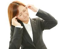 Женщина которое утомлено стоковая фотография