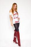 женщина красного цвета колена ботинок высокая стоковая фотография rf