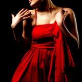 женщина красного цвета платья стоковое изображение