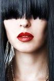 женщина красного цвета портрета губ стороны крупного плана Стоковое фото RF