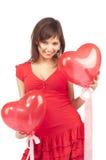 женщина красного цвета сердца воздушного шара Стоковая Фотография