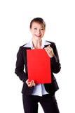 женщина красного цвета удерживания визитной карточки счастливая Стоковая Фотография RF