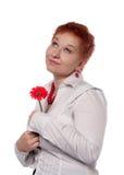 женщина красного цвета цветка Стоковая Фотография