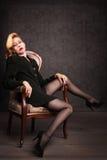 женщина кресла красивейшая Стоковое Фото