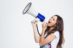Женщина кричащая на громкоговорителе стоковое фото rf
