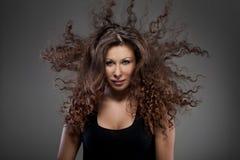 женщина курчавых волос воздуха красивейшая стоковые изображения
