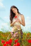 женщина мака поля Стоковая Фотография RF