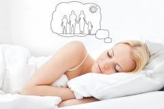 Женщина мечтая иметь семью совместно Стоковые Изображения RF