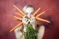 женщина морковей Стоковая Фотография