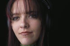 женщина наушников Стоковые Изображения RF