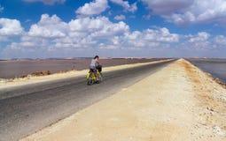Женщина на велосипеде стоковые фото