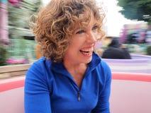 Женщина на езде детей Стоковые Фото