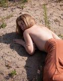 Женщина на пляже Стоковая Фотография