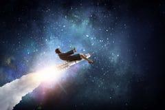 Женщина на ракете космоса Мультимедиа Стоковые Изображения