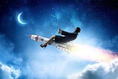 Женщина на ракете космоса Мультимедиа Стоковые Фото