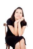 Женщина на стуле Стоковые Изображения
