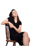 Женщина на стуле Стоковые Изображения RF