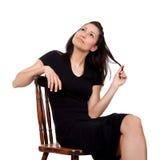 Женщина на стуле Стоковые Фотографии RF