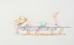 Женщина на sunbed Стоковые Изображения RF