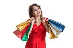 женщина ног принципиальной схемы мешка предпосылки ходя по магазинам белая Молодая счастливая милая женщина держит много хозяйств Стоковая Фотография RF