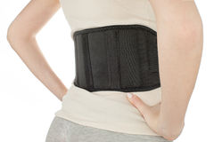 Женщина нося назад пояс поддержки изолированный на белизне Стоковое фото RF