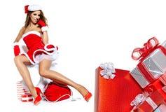 Женщина нося одежды Santa Claus Стоковое Изображение